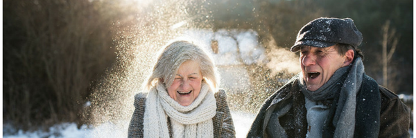 older adults playing in snow
