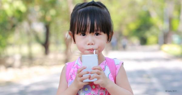 Girl drinking a juice box