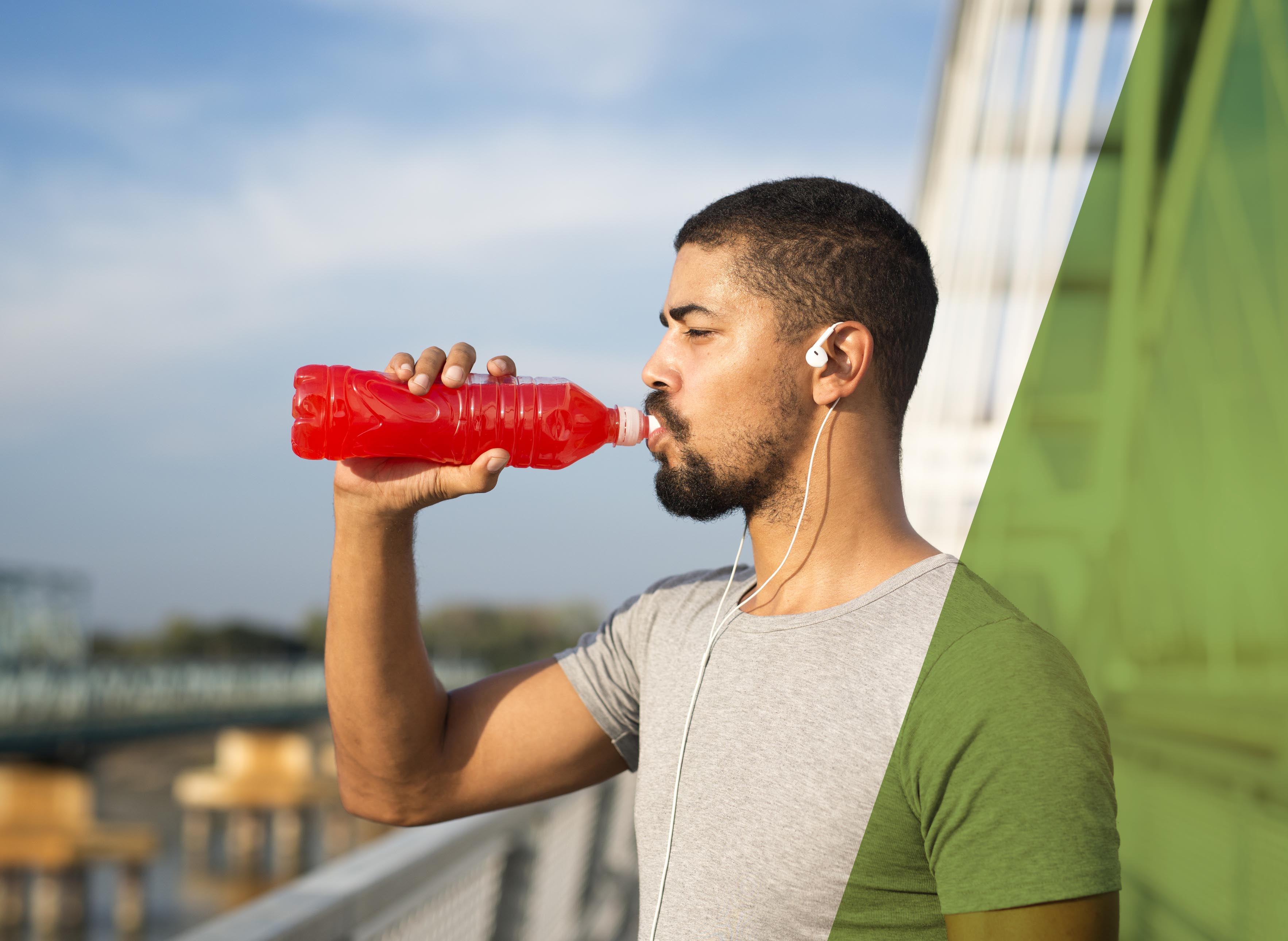 An athlete drinking juice for energy and training.